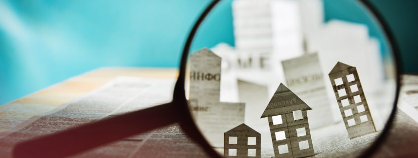 housing under magnifying glass